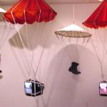 """Free Fall"", 1999, Kinetic Video Installation, Parachutes, Electronics, Video, Motors, Mechanics, Memorabilia Variable Dimensions"